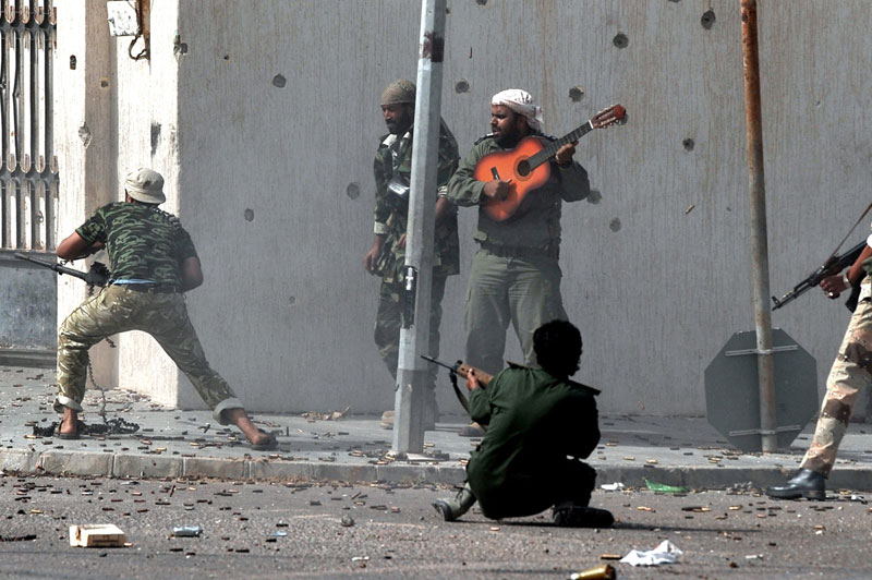 libyan-civil-war-revolution-guitar-player-2011-bard-qatar-hero